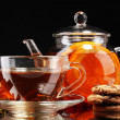 Glass teapot and cup with black fruit tea and cookies isolated on white — Stock Photo #18748979