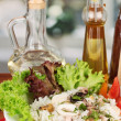 Stock Photo: Delicatessen seafood salad with rice on bright background