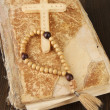 Bible, rosary and cross on wooden table close-up — Stock Photo #18749751