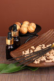 Aromatherapy setting on brown background — Stock Photo