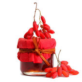Ripe barberries and jar of jam isolated white — Stock Photo