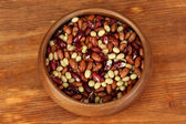 Wooden bowl with beans on wooden background — Stock Photo