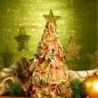 Beautiful christmas tree of dry lemons with decor, on shine green background - Foto Stock