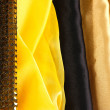 Pile of different fabrics close-up background - Stockfoto