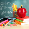 Back to school - blackboard with pencil-box and school equipment on table — Stock Photo #18750437
