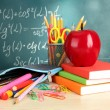 Back to school - blackboard with pencil-box and school equipment on table - Stock fotografie