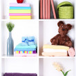 Beautiful white shelves with different baby related objects — Stock Photo #18750845