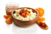 Cottage cheese in bowl with homemade tangerine jam, isolated on white — Stock Photo