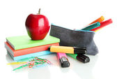 Pencil box with school equipment and apple isolated on white — Stock Photo