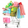 Christmas gifts and shopping in trolley isolated on white - Stok fotoğraf