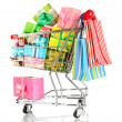 Christmas gifts and shopping in trolley isolated on white - Stockfoto