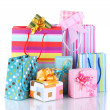 Stock Photo: Bright gift bags and gifts isolated on white