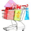 Christmas gifts and shopping in trolley isolated on white - 图库照片