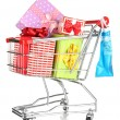 Christmas gifts and shopping in trolley isolated on white - Photo