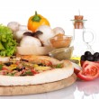 Delicious pizza on wooden board, vegetables, spices and oil isolated on white — Stock Photo
