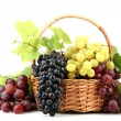 Assortment of ripe sweet grapes in basket, isolated on white — Stock Photo #18847045
