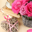 Royalty-Free Stock Photo: Beautiful pink roses in vase on wooden table close-up