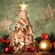 Beautiful christmas tree of dry lemons with decor, on grey background - 