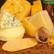 Various types of cheese on wooden table close up - 图库照片
