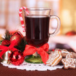 Royalty-Free Stock Photo: Hot tasty drink with christmas candy and other decorations on bright background