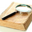 Magnifying glass and book isolated on white — Stock Photo #18848757