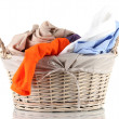 Bright clothes in laundry basket, isolated on white — Stock Photo