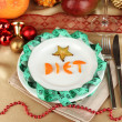 Stock Photo: Dietary food on New Year's table close-up