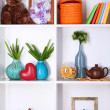 Beautiful white shelves with different home related objects — Stock Photo #18849297