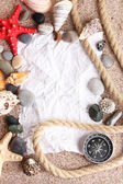 Blank paper on sand beach with seashells and starfishes — Stockfoto