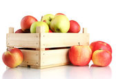Juicy apples in wooden crate, isolated on white — Stock Photo