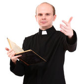 Young pastor with Bible, isolated on white — Stock Photo