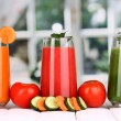 Fresh vegetable juices on wooden table, on window background — Stock Photo #18922745