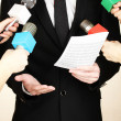 Conference meeting microphones and businessman — Stock Photo #18922933