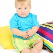 Little boy and color pillows, isolated on white — Stock Photo