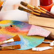 Artistic equipment: paint, brushes and art palette — Stock Photo