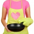 Stock Photo: Closeup of homemaker in apron holding pisolated on white