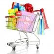 Christmas gifts and shopping in trolley isolated on white - Foto de Stock