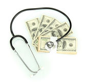 Healthcare cost concept: stethoscope and dollars isolated on white — Foto Stock