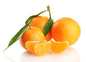 Ripe sweet tangerine with leaves, isolated on white — Stock Photo