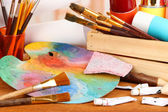 Artistic equipment: paint, brushes and art palette — Stockfoto