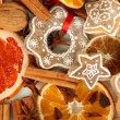 Dried citrus fruits, spices and cookies close-up background — Stockfoto