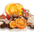 Dried citrus fruits, spices and cookies isolated on white — Stockfoto