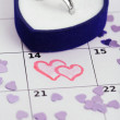 Notes on the calendar (valentines day) and wedding ring, close-up — Stock Photo