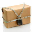 Photo: Parcel with chain and padlock, isolated on white