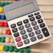 Royalty-Free Stock Photo: Bright wooden toy abacus and calculator, close up