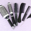 Black combs on color background — Stock Photo #18997731