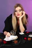 Witch - fortune teller on color background — Stock Photo