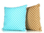 Blue and brown bright pillows isolated on white — Stock Photo