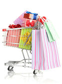 Christmas gifts and shopping in trolley isolated on white — Zdjęcie stockowe