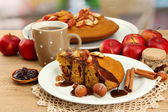 Slice of tasty homemade pie with chocolate and apples and cup of coffee, on wooden table — Stock Photo